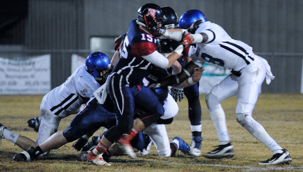 Kingwood's C'Yontai Lewis (No. 8) attempts to tackle a Bessemer Academy ballcarrier in a 35-7 loss in the AISA semifinals Nov. 15. (Contributed/Diane Cunnignham)