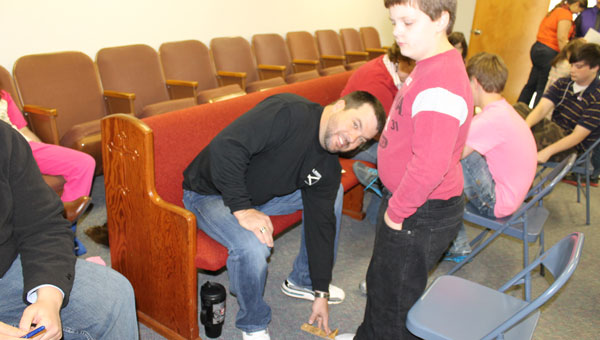 Joshua Ledbetter gets fitted for shoes by Master Mason James White. (Contributed)