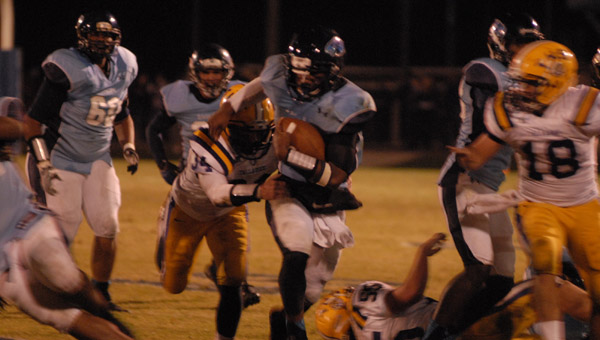 Calera's Ronnie Clark shakes off a tackler in a 21-10 win over Tallassee on Nov. 8. (Reporter Photo/Drew Granthum)