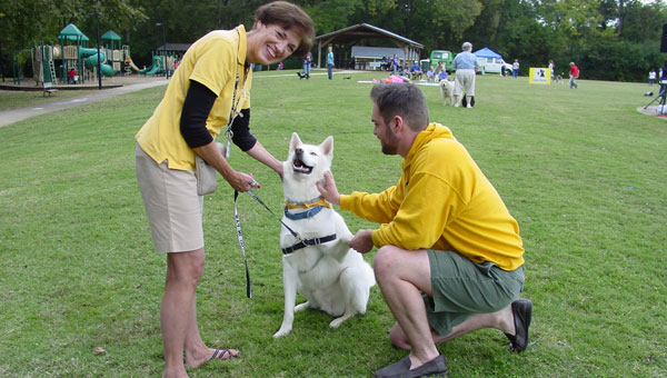 Cody greets a friend, Michael Tallon, as owner Michelle Pawlik looks on. (contributed)