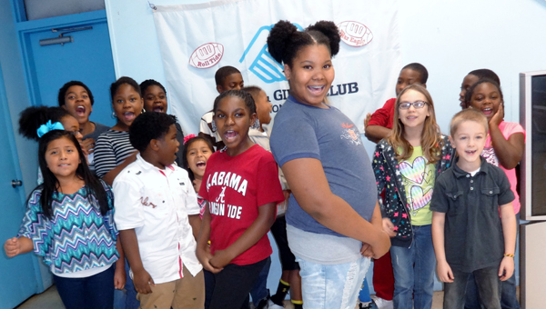 Kayce Sankey, left, and Alyse Jones, right, were recently named semi-finalists in the Triple Play Fit Family Challenge, a national competition sponsored by the Boys and Girls Club. During Iron Bowl week, the girls are involving fellow Boys and Girls Club members in fitness competitions. (Contributed)