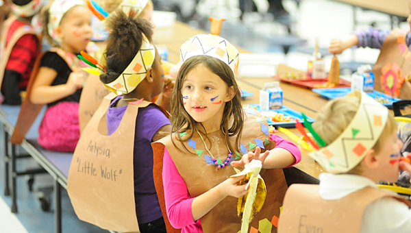 Creek View Elementary School kindergarteners dress as Native Americans in observance of the school's Thanksgiving lunch on Nov. 20. (Reporter Photo/Jon Goering)