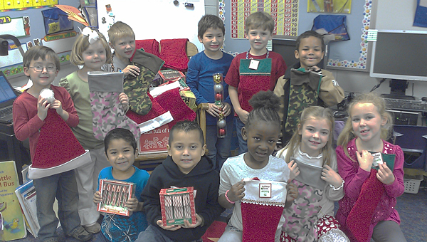 Students in Julie Howanitz's class at Meadow View Elementary School recently collected Christmas items to ship to soldiers stationed overseas. (Contributed)