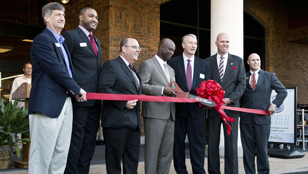 Winn-Dixie opened its new store at Inverness Corners shopping center Nov. 20. Picture, from left, Mike Lewellen, Jerome Morgan, Jim Rossetti, Eugene Okorley, Tim Flavin, John Lyda and Joe Thomas (Contributed)