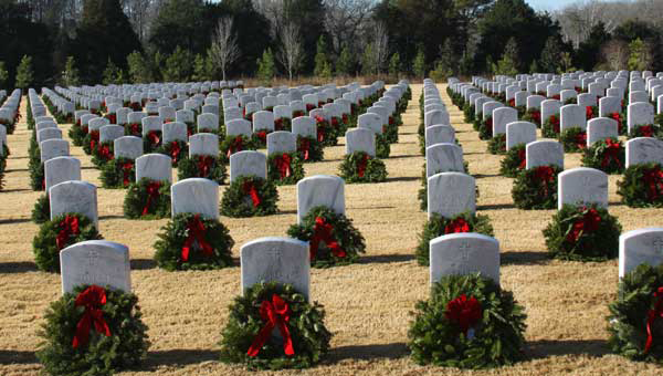 Veterans' graves marked with wreathes during the holiday season at the Alabama National Cemetery.