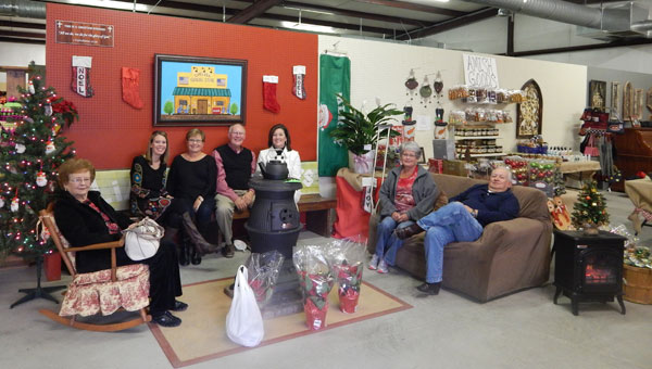 """Danolyn """"Nana"""" Poole, Lori Harris, co-owners Mary and Dale Neuendorf, Wendy McDougal, Nita Stringfellow, Gary Stringfellow enjoy Chelsea General Stores' grand opening on Dec. 18.  (contributed)"""