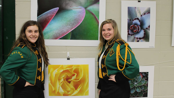 Kaitie Read and Nikki DeVenny pose by artwork before the band concert began. (Contributed)