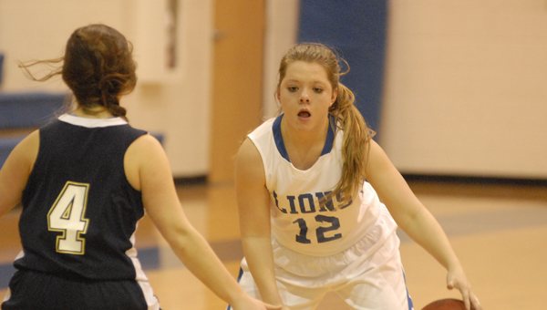 Kingwood's Addyson Moncreif dribbles in for a shot against Russell Christian on Dec. 9. (Reporter Photo/Drew Granthum)