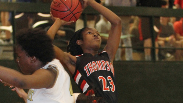 Thompson's Janese Richardson fires a shot while falling back against Pelham Dec. 3. (Contributed/Eric Starling)