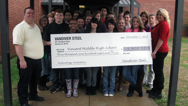 Vandiver Steel recented donated $3,908.52 to Vincent High School for the school to purpose 20 Kindle Fires. (Contributed)