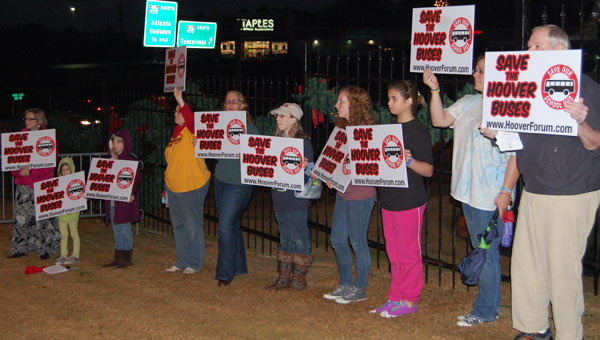 Members of the grassroots group Save the Hoover Buses quietly protest at the city of Hoover's Christmas Tree Lighting Ceremony Dec. 2. (Reporter Photo/Cassandra Mickens)