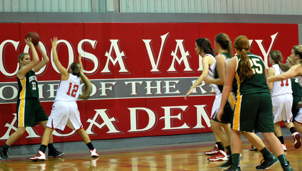 Members of Coosa Valley Academy's girls basketball team work a full court press early on Edgewood Academy Dec. 3. (Contributed)