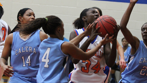 Montevallo's Myshael Thompson drives to the basket in a matchup with Calera Dec. 10. (Contributed/Amy Pintaro)