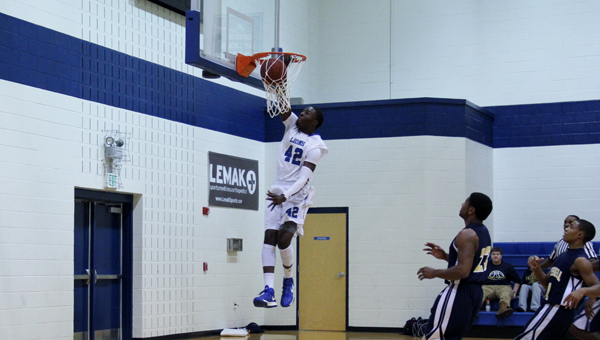 Kingwood's C'Yontai Lewis goes up for a huge dunk in a big win against Russell Christian (Miss.) on Dec. 9. (Contributed/Diane Cunningham)