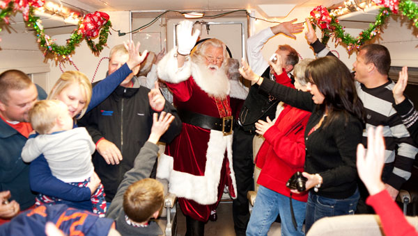 Santa Claus visits with families on the Heart of Dixie Railroad's Polar Express. (contributed)