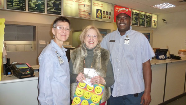 DAR member Lucy Carpenter, (center, with USPO employees Marlene Abate and former Marine Keith Scott  at the Alabaster Post Office. (contributed)