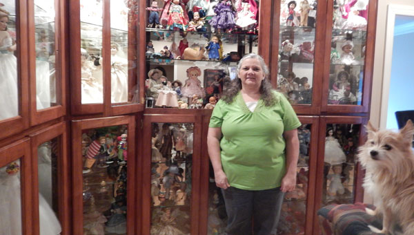 Traveling to Third World countries with her work as an adult, Debbie Pope added several prized dolls to the collection she began as a teenager living in a foster home. (contributed)