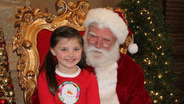Pelham resident Olivia Orton, age 7, visits with Santa at Ballantrae on Dec. 14. (Contributed)
