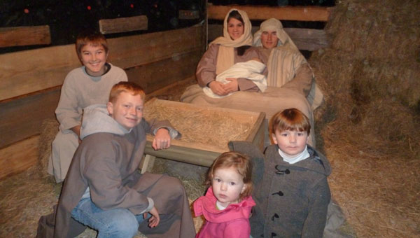 """Mary, Joseph and baby Jesus pose with visitors during """"A Walk through Bethlehem."""" From left, Grayson Littleton, Bailey, Merrell and Jordan Howard, Skyler Martin, Tripp and Rushton Robinson. (contributed)"""