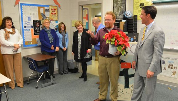 Spain Park High School social studies teacher Craig Thompson, second from right, was surprised with the news of being named Hoover City Schools' Secondary Teacher of the Year Dec. 16. Superintendent Andy Craig, far right, was on hand for the surprise ceremony. (Contributed)