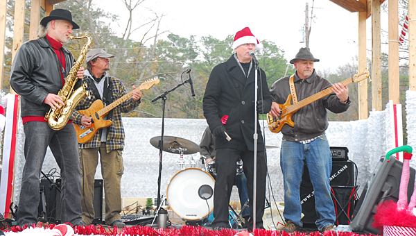 2 Blu and the Lucky Stiffs perform on a float in Alabaster's Christmas parade on Dec. 7. (Reporter Photo/Neal Wagner)