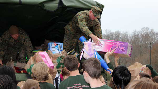 Oak Mountain Middle School students assist Marines in loading the toys, which completely filled the transport vehicle.