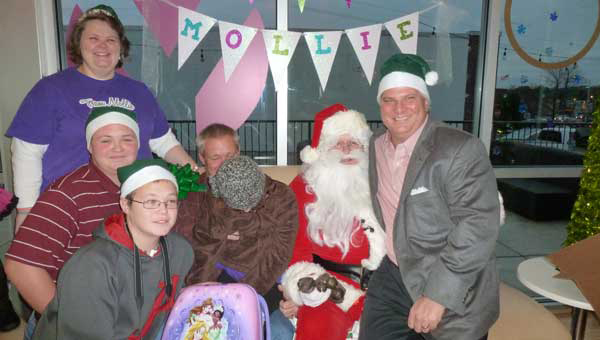 Reneé Stephen, Austin, Scott and Mollie Wilder with Santa and Ed Aldag, Jr. Santa granted Mollie's wish to go to Disney World that was coordinated by Magic Moments and funded by employees of Medical Properties Trust, Inc.
