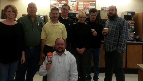 Some members of the Roo Crew, from left, Susan Lambert, Charlie Pope, Pastor Tim Cox, Jeff Seabold (kneeling), Murray Legg, Olean Kenny, Todd Brasher and Shane Epperson.