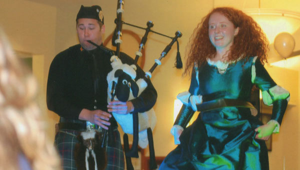 Bagpiper Dallas Key and Merida the Brave perform at the 2013 Fairy Tale Ball in Calera. (contributed)