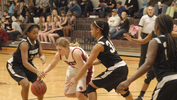 Shelby County's Marjorie Head dives for a ball in a Jan. 9 matchup with Vincent. (Reporter Photo/Drew Granthum)