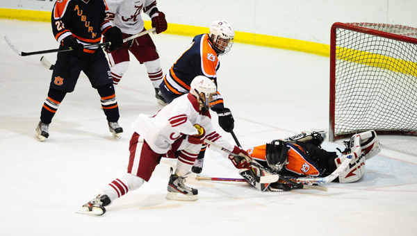 An Alabama hockey player reaches in for a wrist shot in the Iron Cup rivalry. The Frozen Tide swept the Tigers, 3-0 to take their fourth-consecutive win in the series. (Reporter Photo/Jon Georing)