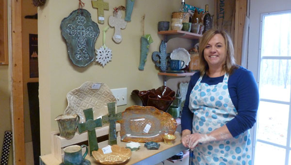 Sandra Annonio in her pottery studio with some of her art on display that will be available for sale at the Celebration of Shelby County Arts Council fashion show luncheon benefit Feb. 8. (contributed)