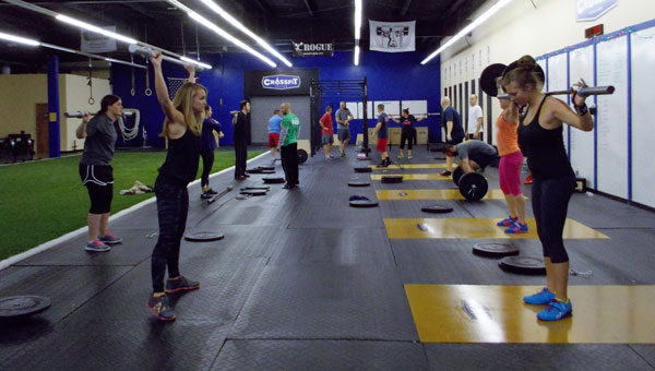 Crossfit members enjoy a class. (contributed)
