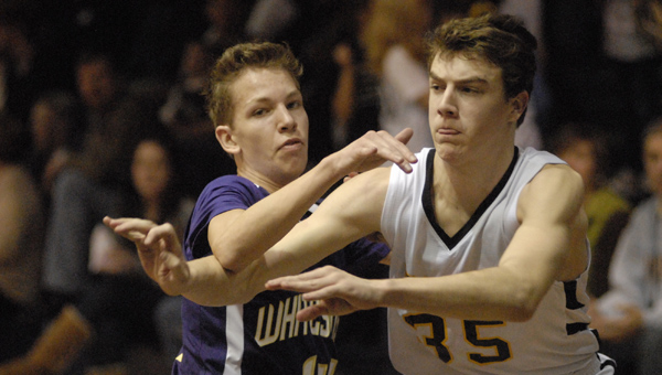 Westminster's Keller Dogget battles with a Whitesburg defender in a Jan. 25 matchup. The Knights won the game, which was held on homecoming weekend. (Reporter Photo/Drew Granthum)