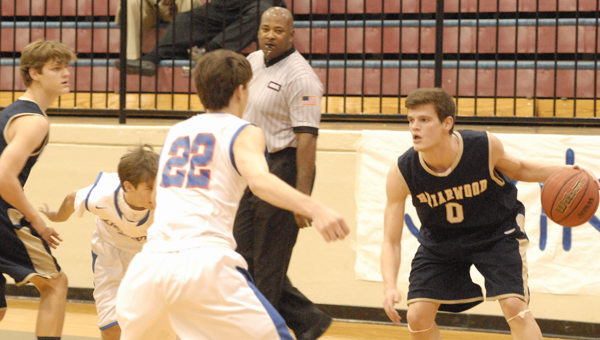 Josh Laatsch (No. 0) drives in for a basket in a Jan. 3 matchup with Vestavia Hills. (Reporter Photo/Drew Granthum)