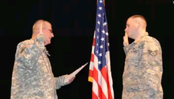 Goke's uncle, United States Army Chief Warrant Officer 4 William B. Pike Jr. administers the oath of reenlistment. (contributed)
