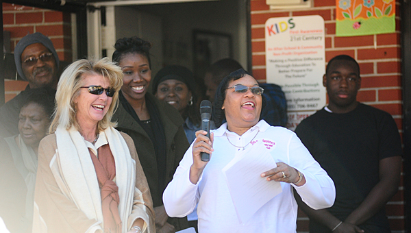 Alabaster Mayor Marty Handlon and Kids First Community Center Director Cindy Hawkins share a laugh during a presentation in front of the community center on Martin Luther King, Jr. Day, Jan. 20. (Reporter Photo/Jon Goering)