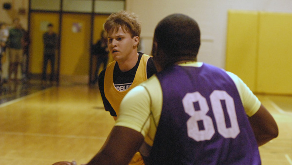 Gold Side's Derek Kennedy drives in for a basket in the Univeristy of MOntevallo's annual College Night men's basketball game. (Reporter Photo/Drew Granthum)