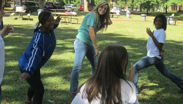 FTA local and state president Emily Colley, senior at MHS, leads eighth graders in a team-building game called Ninja at the University of Montevallo's Future Falcon Day. (contributed)