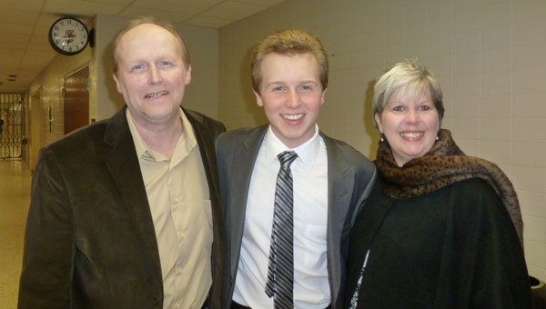 Austin Foster with his parents Ron and Kim Foster. (contributed)