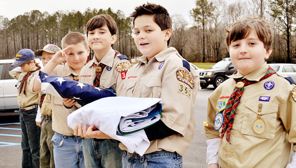 Forest Oaks Elementary surmounts another historic milestone as the colors are posted by the Forest Oaks Cub Scout Pack #353 in a special ceremony. (contributed)