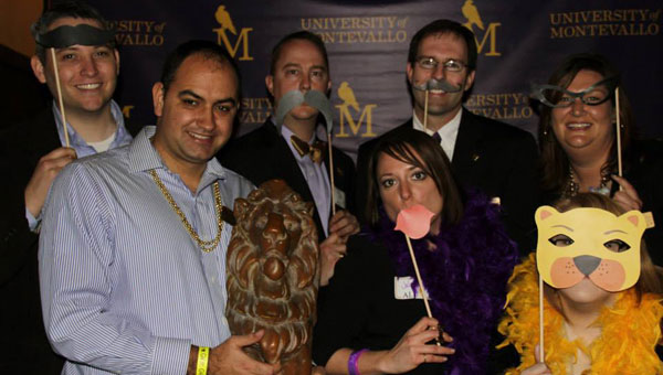 The executive officers of the Univeristy of Montevallo Junior Board of Directors have fun in the photo booth at the Young Alumni Mixer. From left, Rick Casey, Jason Booi, Jeff Purvis, Julie Harbin, Patrick McDonald, Tiffany Bunt and Lindsey Sherrill. (contributed)