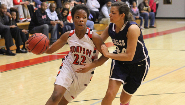 Thompson's Indiah Cohill tries to drive past Oak Mountain's Sara Garrard in a Feb. playoff matchup. (Contributed/Eric Starling)