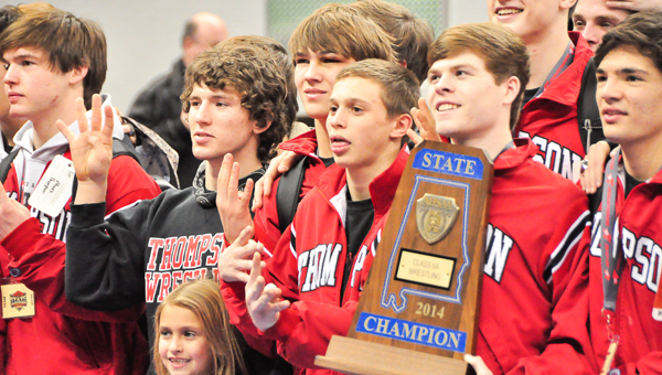 Members of the Thompson wrestling team celebrate after capturing their fourth-straight AHSAA Class 6A State Championship. (Brent Maze/Hartselle Inquirer)