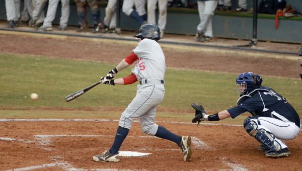 Oak Mountain's Skylar Gossett drives a ball up the middle in a 7-2 loss to Briarwood Christian Feb. 19. (Reporter Photo/Drew Granthum)