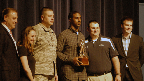 Calera's Ronnie Clark was awarded the USA Today Inspiration Award Feb. 18 for his success on the field, and overcoming challenges off it. The award is presented in conjunction with the National Guard. (Reporter Photo/Drew Granthum)