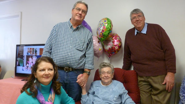 Mrs. Emmie McDonald (seated) celebrated her 90th birthday at Fourmile Baptist Church with her children, Nancy McDonald Paden, Tommy McDonald and Randy McDonald. (contributed)