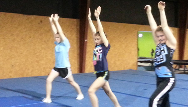 Loud-N-Proud Cheernastics cheerleaders in training. From left, Anna Wise, Alexus Martin and Kayleigh Dean. (contributed)