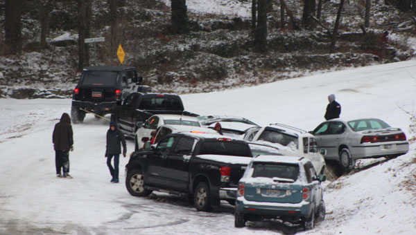 Cars line the side of Shelby County 52 in Pelham during a snowstorm on Jan. 28. (Contributed/Ashley Williams)