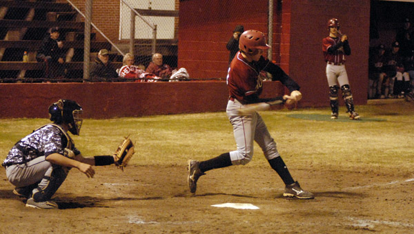Shelby County's Nick Lowery drives a ball to the outfield in a Feb. 28 win. (Reporter Photo/Drew Granthum)